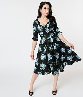 696481e01b0 UNIQUE VINTAGE 1950s Black and Blue Rose Floral Print Delores Swing Dress  With sleeves