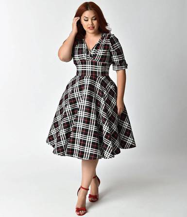 6f3f96877 A gorgeous swing dress cast in 1950s vintage appeal, The Delores Dress from Unique  Vintage is marvelous with a beautiful black, white, and red plaid print.